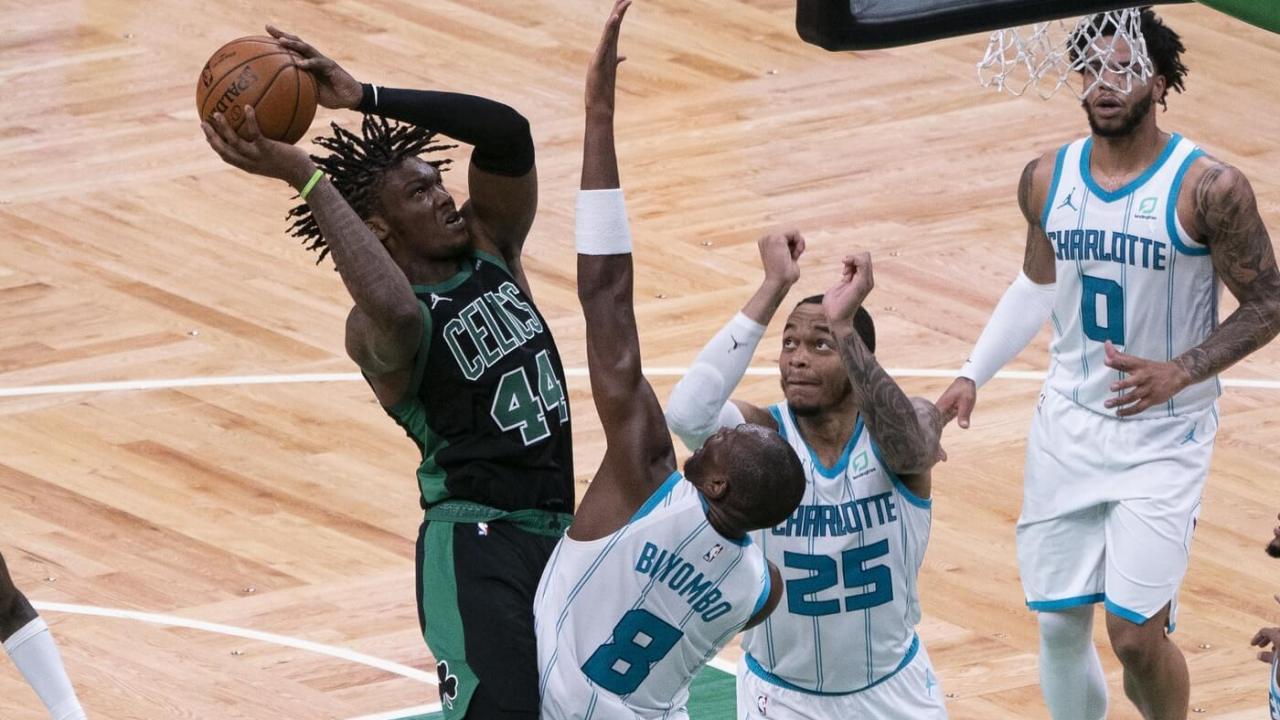 Apr 4, 2021; Boston, Massachusetts, USA; Boston Celtics center Robert Williams III (44) shoots a floater over Charlotte Hornets center Bismack Biyombo (8) defending during the third quarter at TD Garden. Mandatory Credit: Gregory Fisher-USA TODAY Sports