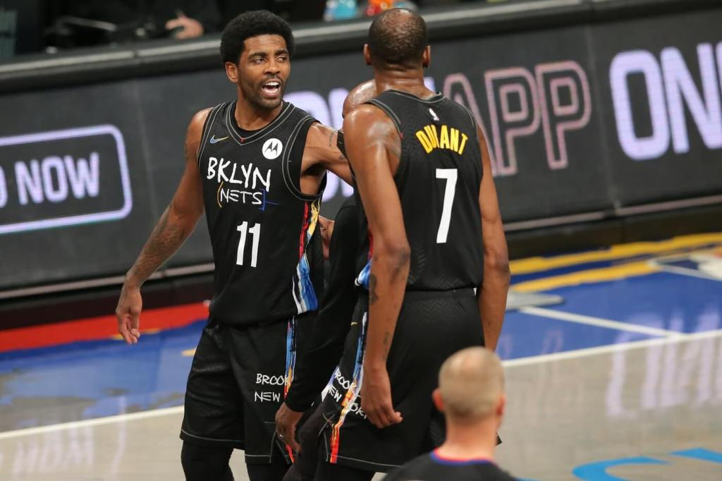 Apr 10, 2021; Brooklyn, New York, USA; Brooklyn Nets point guard Kyrie Irving (11) reacts as he leaves the game against the Los Angeles Lakers after being ejected during the third quarter at Barclays Center. Mandatory Credit: Brad Penner-USA TODAY Sports