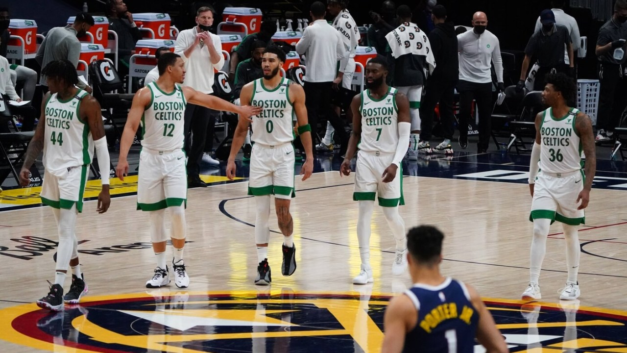 Apr 11, 2021; Denver, Colorado, USA; Boston Celtics center Robert Williams III (44) and forward Grant Williams (12) and forward Jayson Tatum (0) and guard Jaylen Brown (7) and guard Marcus Smart (36) during the fourth quarter against the Denver Nuggets at Ball Arena.