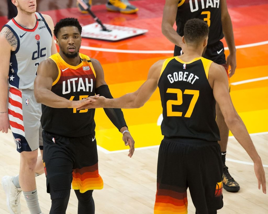 Apr 12, 2021; Salt Lake City, Utah, USA; Utah Jazz guard Donovan Mitchell (45) and center Rudy Gobert (27) react during the first half against the Washington Wizards at Vivint Smart Home Arena. Mandatory Credit: Russell Isabella-USA TODAY Sports