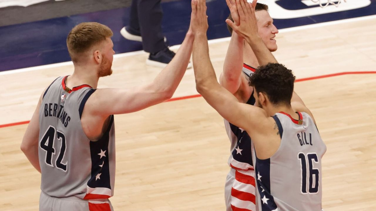 Washington Wizards forward Davis Bertans (42) celebrates with Wizards forward Anthony Gill (16) and Wizards guard Garrison Mathews (24) after their game against the Cleveland Cavaliers at Capital One Arena.