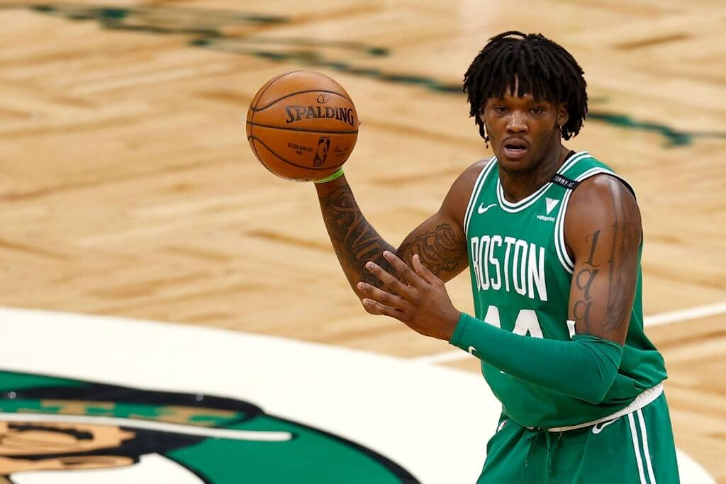 BOSTON, MASSACHUSETTS - FEBRUARY 17: Robert Williams III #44 of the Boston Celtics looks to pass against the Denver Nuggets during the second half at TD Garden on February 17, 2021 in Boston, Massachusetts. NOTE TO USER: User expressly acknowledges and agrees that, by downloading and or using this photograph, User is consenting to the terms and conditions of the Getty Images License Agreement.  (Photo by Maddie Meyer/Getty Images)