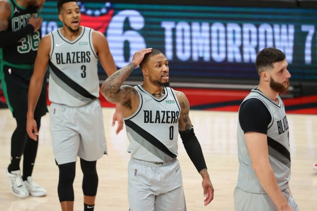 PORTLAND, OREGON - APRIL 13: Damian Lillard #0 of the Portland Trail Blazers reacts during the final seconds of play in the fourth quarter against the Boston Celtics at Moda Center on April 13, 2021 in Portland, Oregon. NOTE TO USER: User expressly acknowledges and agrees that, by downloading and or using this photograph, User is consenting to the terms and conditions of the Getty Images License Agreement. (Photo by Abbie Parr/Getty Images)