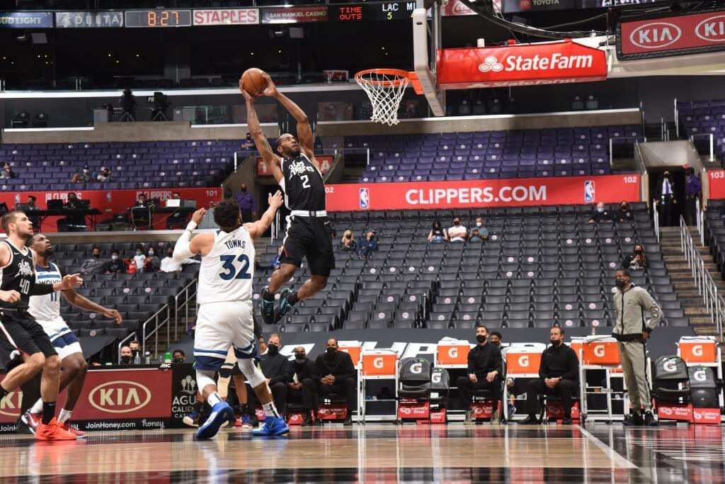 LOS ANGELES, CA - APRIL 18: Kawhi Leonard #2 of the LA Clippers dunks the ball during the game against the Minnesota Timberwolves on April 18, 2021 at STAPLES Center in Los Angeles, California. NOTE TO USER: User expressly acknowledges and agrees that, by downloading and/or using this Photograph, user is consenting to the terms and conditions of the Getty Images License Agreement. Mandatory Copyright Notice: Copyright 2021 NBAE (Photo by Andrew D. Bernstein/NBAE via Getty Images)