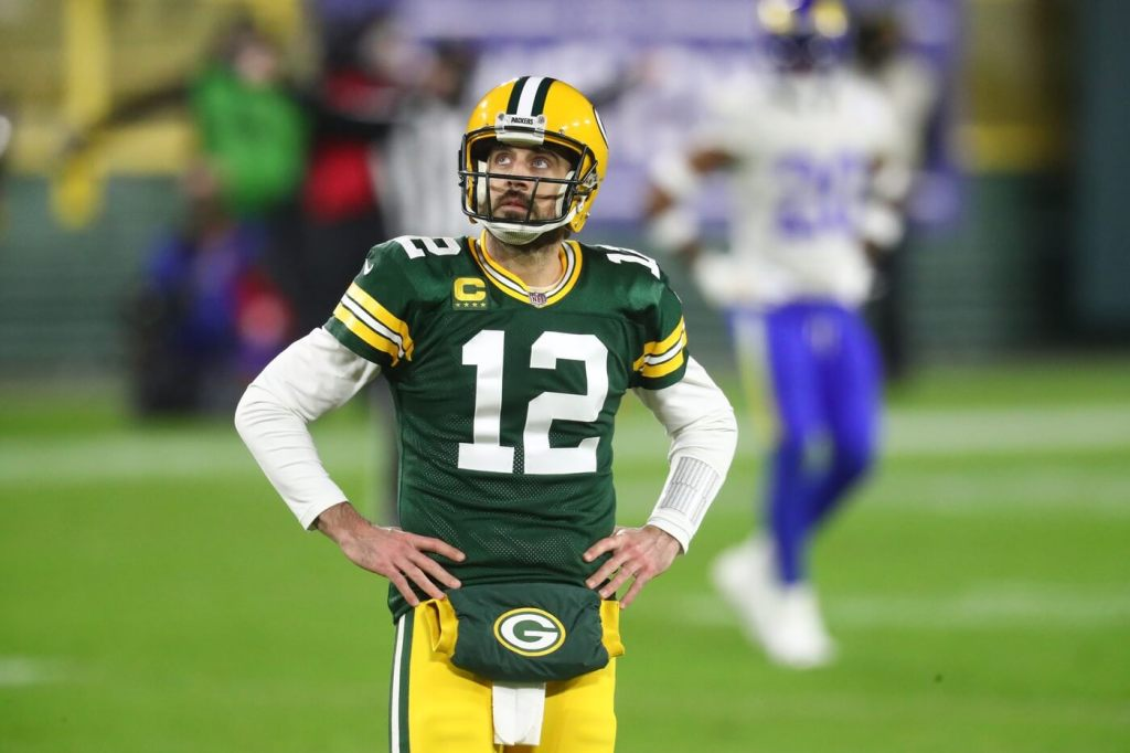 Jan 16, 2021; Green Bay, Wisconsin, USA; Green Bay Packers quarterback Aaron Rodgers (12) looks up during the second half of a NFC Divisional Round playoff game against the Los Angeles Rams at Lambeau Field. Mandatory Credit: Mark J. Rebilas-USA TODAY Sports