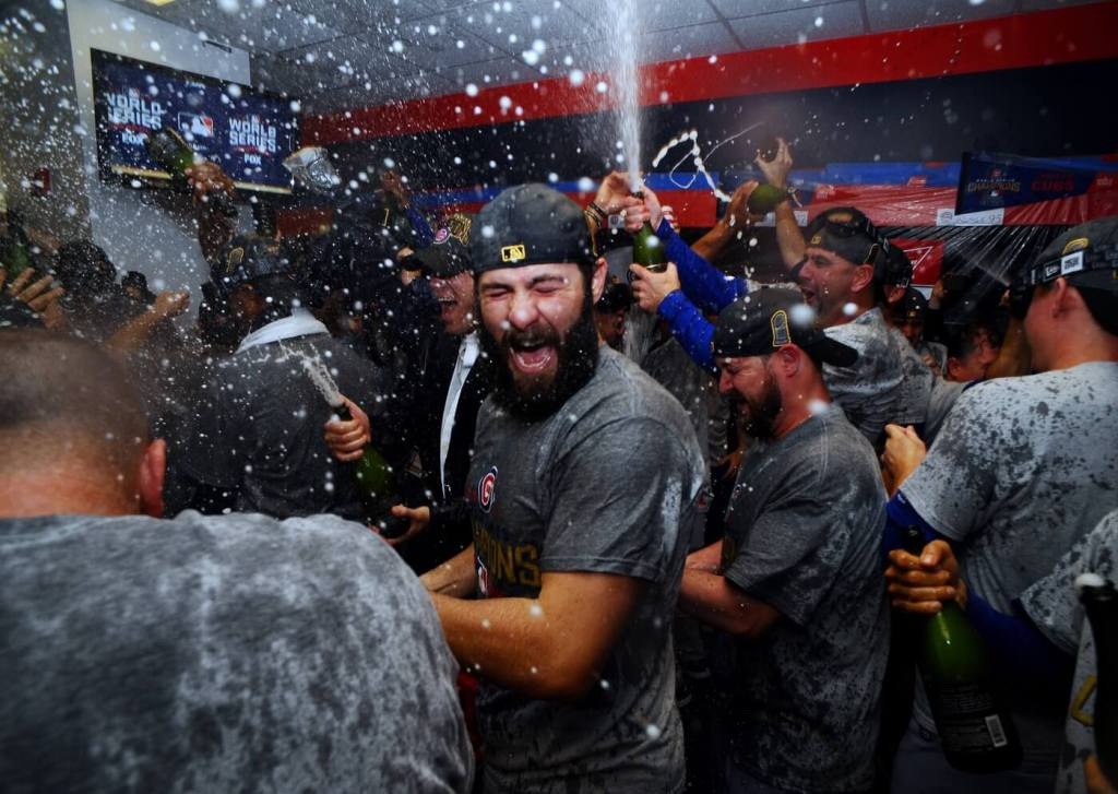 Nov 2, 2016; Cleveland, OH, USA; Chicago Cubs starting pitcher Jake Arrieta celebrates in the clubhouse after defeating the Cleveland Indians in game seven of the 2016 World Series at Progressive Field. Mandatory Credit: Ken Blaze-USA TODAY Sports