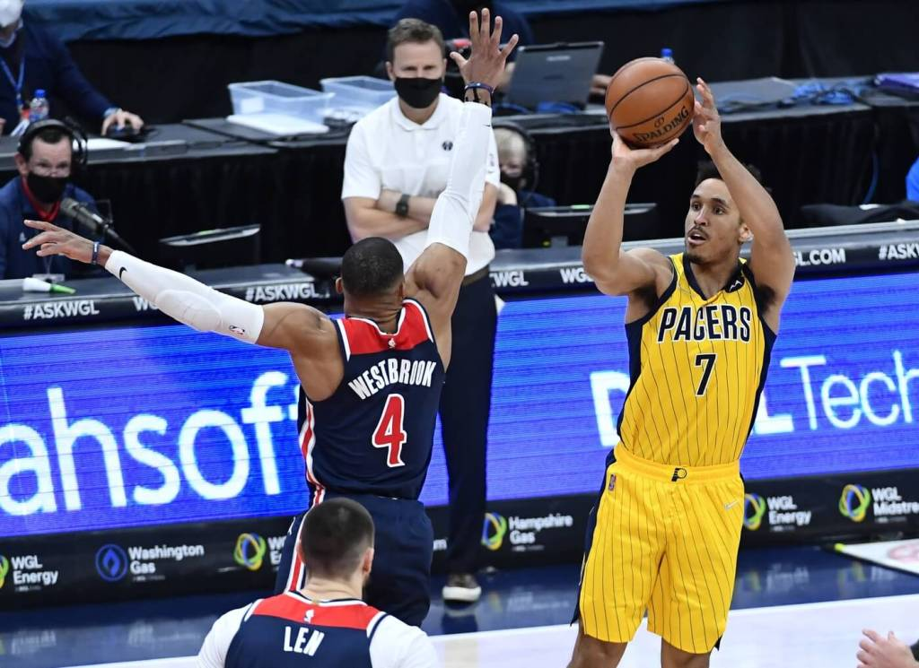 Mar 29, 2021; Washington, District of Columbia, USA; Indiana Pacers guard Malcolm Brogdon (7) shoots the ball over Washington Wizards guard Russell Westbrook (4) during the fourth quarter at Capital One Arena. Mandatory Credit: Brad Mills-USA TODAY Sports