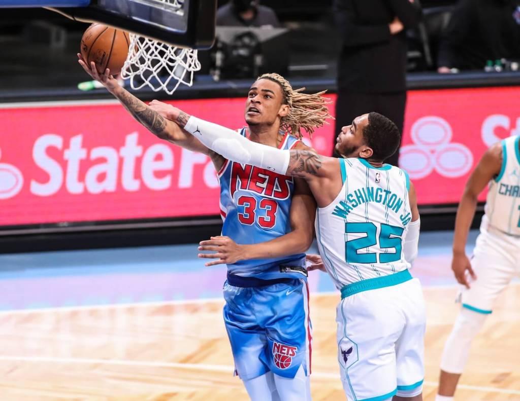 Apr 1, 2021; Brooklyn, New York, USA; Brooklyn Nets forward Nicolas Claxton (33) and Charlotte Hornets forward P.J. Washington Jr. (25) at Barclays Center. Mandatory Credit: Wendell Cruz-USA TODAY Sports