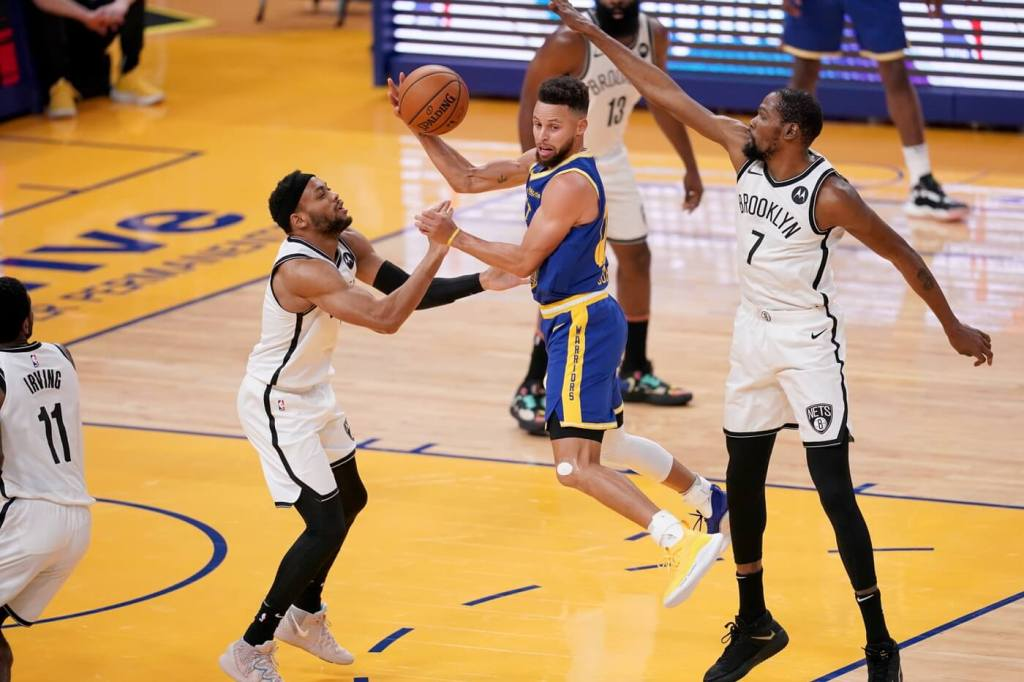 Feb 13, 2021; San Francisco, California, USA; Golden State Warriors guard Stephen Curry (30) passes the ball away from the reach of Brooklyn Nets forward Kevin Durant (7) in the first quarter at the Chase Center. Mandatory Credit: Cary Edmondson-USA TODAY Sports