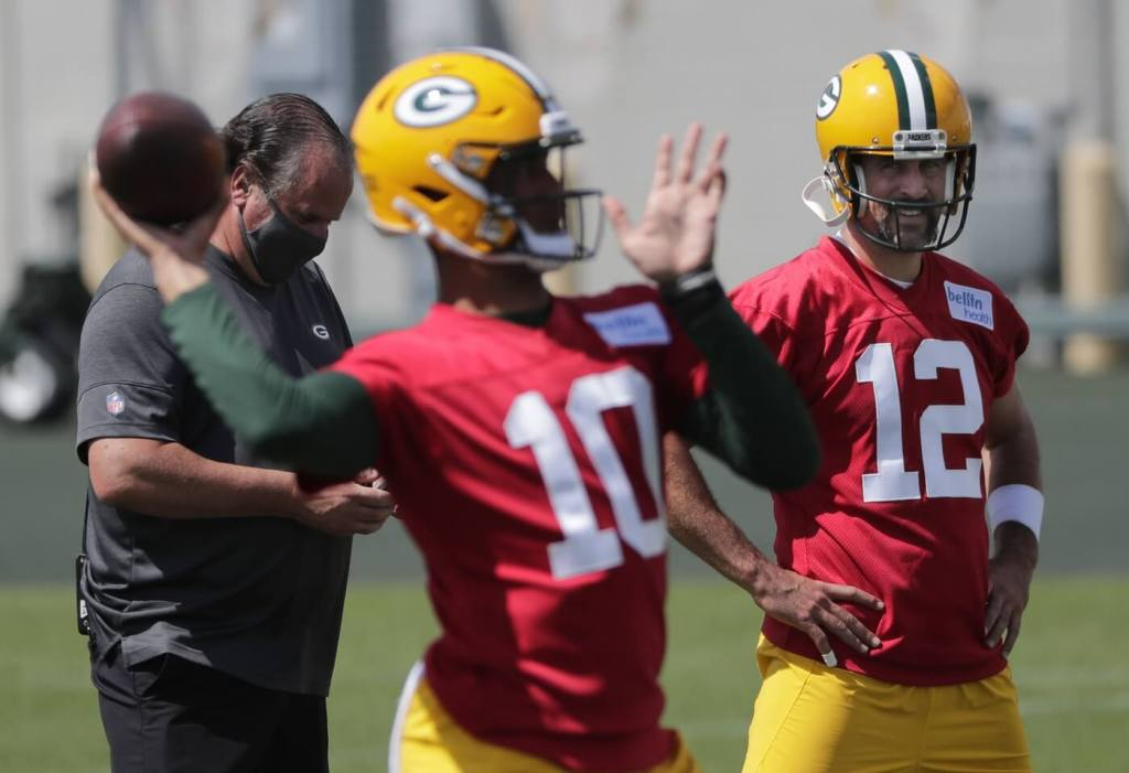 Aug 17, 2020; Green Bay, WI, USA; Green Bay Packers quarterback Aaron Rodgers (12) and quarterback Jordan Love (10) are shown Monday, August 17, 2020, during training camp in Green Bay, Wis. Mandatory Credit: Dan Powers-USA TODAY Sports