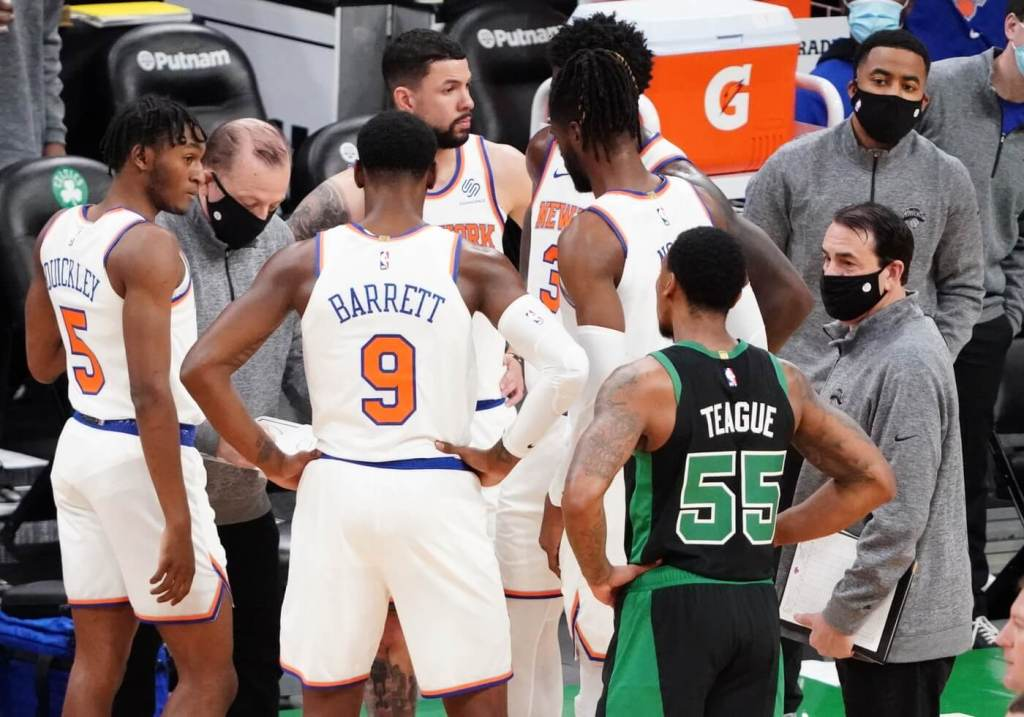 Jan 17, 2021; Boston, Massachusetts, USA; New York Knicks head coach Tom Thibodeau talks to his players as Boston Celtics guard Jeff Teague (55) listens in during a break in the action in the first quarter at TD Garden. Mandatory Credit: David Butler II-USA TODAY Sports