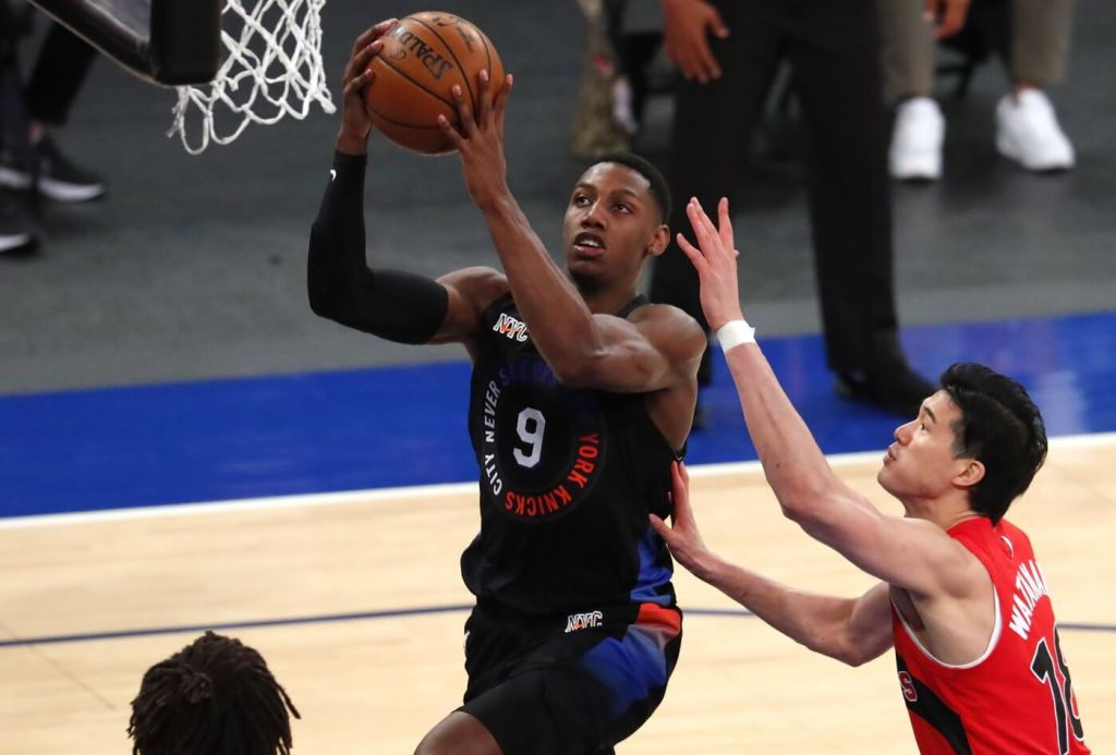 Apr 24, 2021; New York, New York, USA; New York Knicks guard RJ Barrett (9) drives to the basket against Toronto Raptors forward Yuta Watanabe (18) during the second half of an NBA basketball game Saturday, April 24,2021, in New York. Mandatory Credit: Noah K. Murray/Pool Photo-USA TODAY Sports