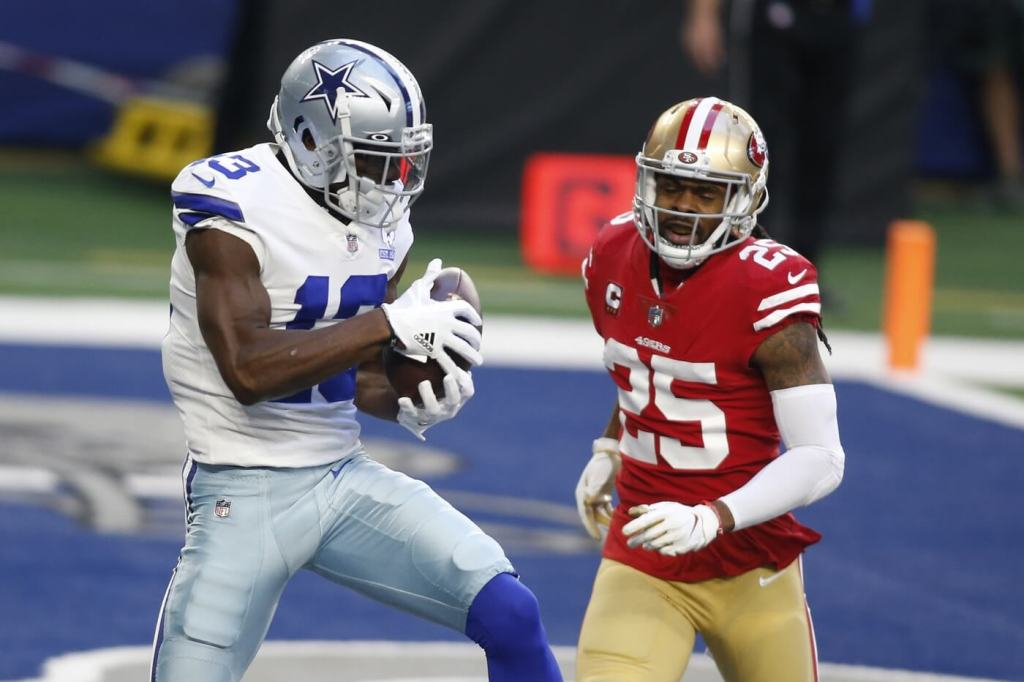 Dec 20, 2020; Arlington, Texas, USA; Dallas Cowboys wide receiver Michael Gallup (13) catches a touchdown pass against San Francisco 49ers cornerback Richard Sherman (25) in the first quarter at AT&T Stadium. Mandatory Credit: Tim Heitman-USA TODAY Sports