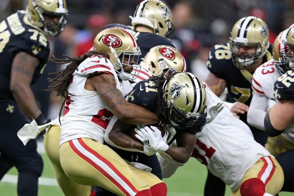 Dec 8, 2019; New Orleans, LA, USA; New Orleans Saints running back Alvin Kamara (41) is tackled by San Francisco 49ers cornerback Richard Sherman (25) in the second half at the Mercedes-Benz Superdome. The 49ers won, 48-46. Mandatory Credit: Chuck Cook-USA TODAY Sports
