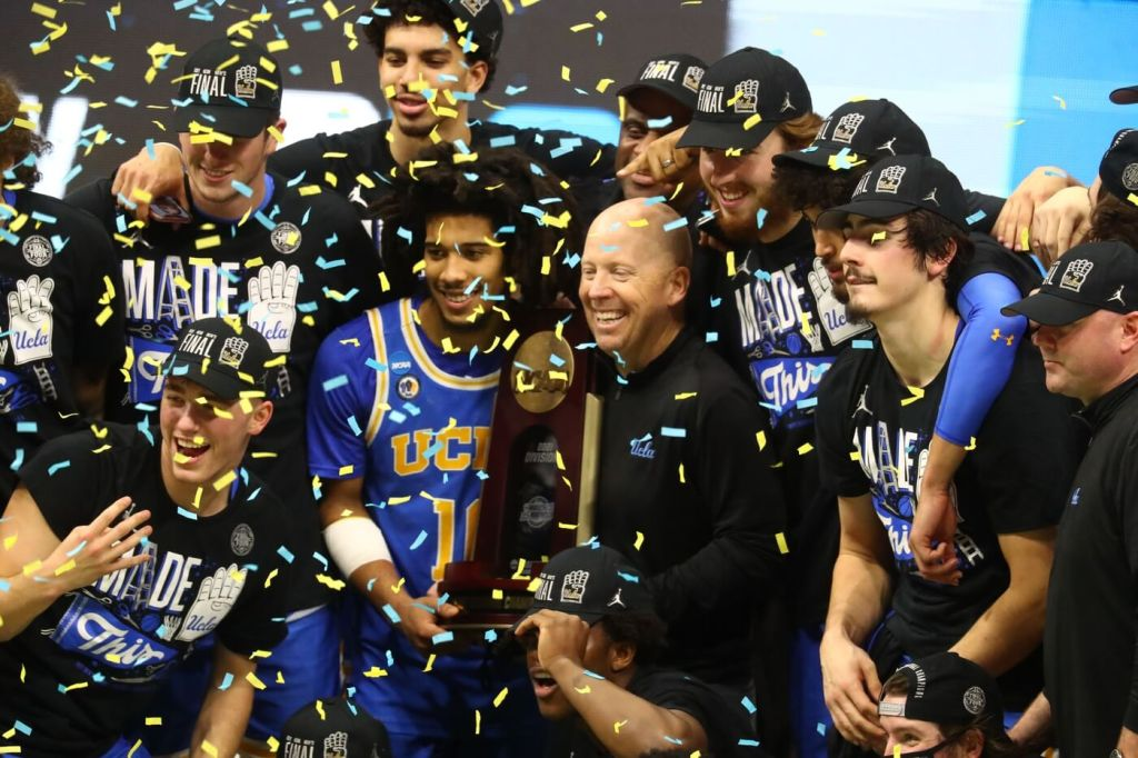 Mar 30, 2021; Indianapolis, IN, USA; The UCLA Bruins celebrate after defeating the Michigan Wolverines in the Elite Eight of the 2021 NCAA Tournament at Lucas Oil Stadium. Mandatory Credit: Mark J. Rebilas-USA TODAY Sports