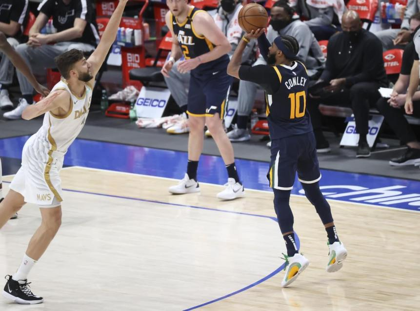 Apr 5, 2021; Dallas, Texas, USA; Utah Jazz guard Mike Conley (10) shoots over Dallas Mavericks forward Maxi Kleber (42) during the fourth quarter at American Airlines Center. Mandatory Credit: Kevin Jairaj-USA TODAY Sports
