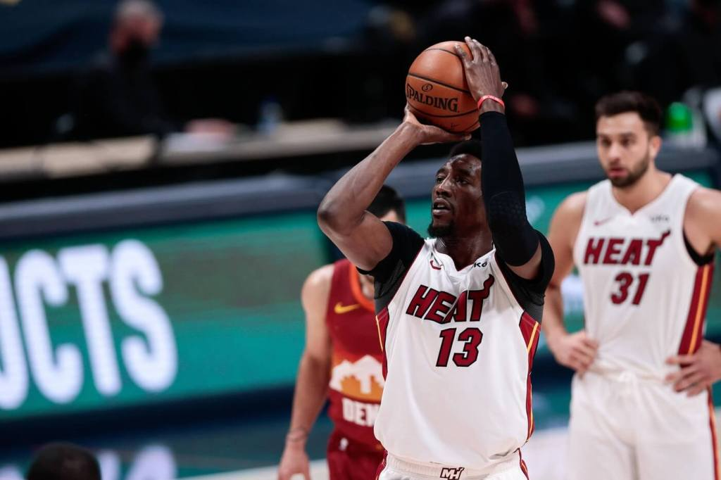 Apr 14, 2021; Denver, Colorado, USA; Miami Heat center Bam Adebayo (13) attempts a free throw in the fourth quarter against the Denver Nuggets at Ball Arena. Mandatory Credit: Isaiah J. Downing-USA TODAY Sports