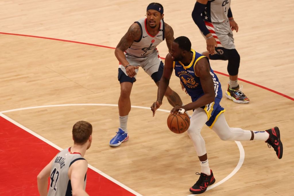 Apr 21, 2021; Washington, District of Columbia, USA; Golden State Warriors forward Draymond Green (23) drives to the basket past Washington Wizards guard Bradley Beal (3) in the fourth quarter at Capital One Arena. Mandatory Credit: Geoff Burke-USA TODAY Sports