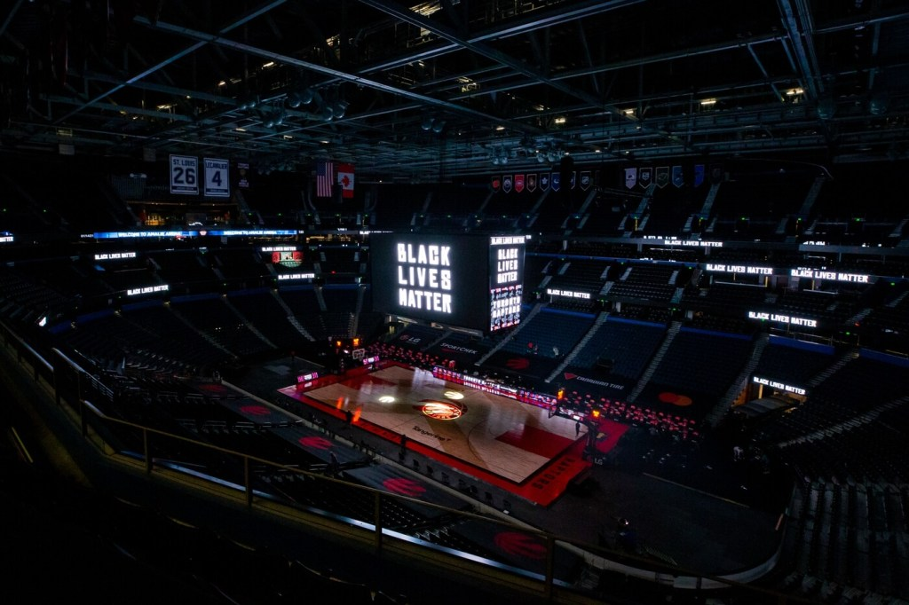 Jan 14, 2021; Tampa, Florida, USA; The video board of Amalie Arena displays 'Black Lives Matter' before a game between the Toronto Raptors and Charlotte Hornets. Mandatory Credit: Mary Holt-USA TODAY Sports