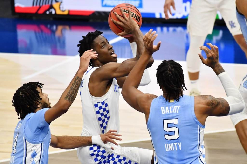 Dec 19, 2020; Cleveland, Ohio, USA; Kentucky Wildcats guard Terrence Clarke (5) drives to the basket against North Carolina Tar Heels guard R.J. Davis (4) and forward Armando Bacot (5) during the first half at Rocket Mortgage FieldHouse. Mandatory Credit: Ken Blaze-USA TODAY Sports