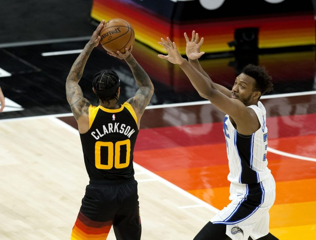 Apr 3, 2021; Salt Lake City, Utah, USA; Utah Jazz guard Jordan Clarkson (00) shoots the ball against Orlando Magic center Wendell Carter Jr. (34) during the first half at Vivint Smart Home Arena. Mandatory Credit: Russell Isabella-USA TODAY Sports