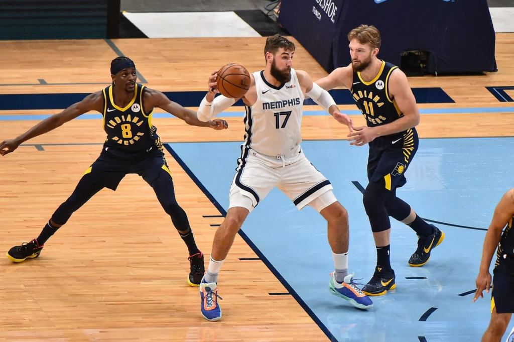 Apr 11, 2021; Memphis, Tennessee, USA; Memphis Grizzlies center Jonas Valanciunas (17) handles the ball against Indiana Pacers forward Domantas Sabonis (11) during the second half at FedExForum. Mandatory Credit: Justin Ford-USA TODAY Sports