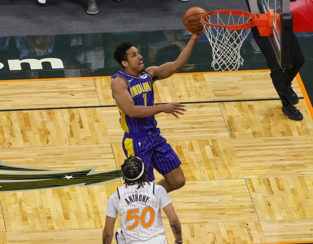 Apr 25, 2021; Orlando, Florida, USA; Indiana Pacers guard Malcolm Brogdon (7) drives to the basket as Orlando Magic guard Cole Anthony (50) looks on during the second half at Amway Center. Mandatory Credit: Mike Watters-USA TODAY Sports