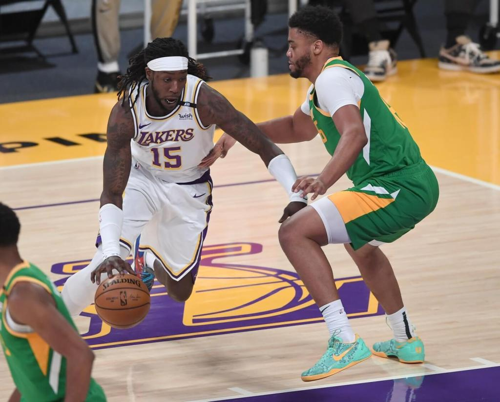 Apr 17, 2021; Los Angeles, California, USA; Los Angeles Lakers center Montrezl Harrell (15) is defended by Utah Jazz forward Juwan Morgan (16) as he drives to the basket in the first half of the game at Staples Center. Mandatory Credit: Jayne Kamin-Oncea-USA TODAY Sports
