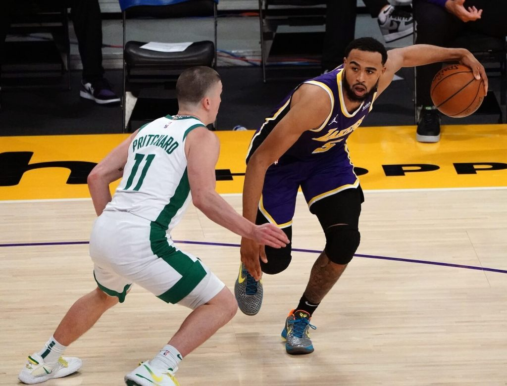 Apr 15, 2021; Los Angeles, California, USA; Los Angeles Lakers guard Talen Horton-Tucker (5) moves the ball against Boston Celtics guard Payton Pritchard (11) during the second half at Staples Center. Mandatory Credit: Gary A. Vasquez-USA TODAY Sports