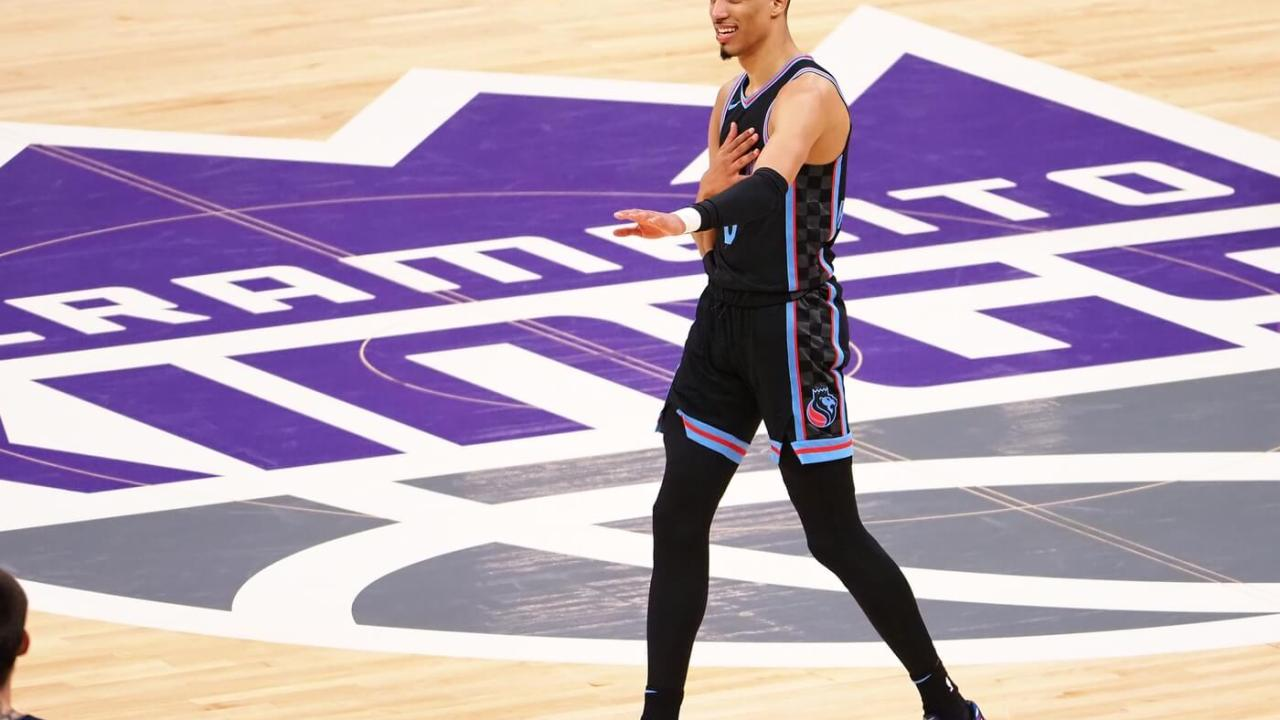 Apr 21, 2021; Sacramento, California, USA; Sacramento Kings guard Tyrese Haliburton (0) gestures after being called for a foul against the Minnesota Timberwolves during the fourth quarter at Golden 1 Center. Mandatory Credit: Kelley L Cox-USA TODAY Sports