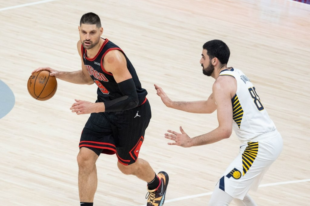Apr 6, 2021; Indianapolis, Indiana, USA; Chicago Bulls center Nikola Vucevic (9) dribbles the ball while Indiana Pacers center Goga Bitadze (88) defends in the third quarter at Bankers Life Fieldhouse. Mandatory Credit: Trevor Ruszkowski-USA TODAY Sports