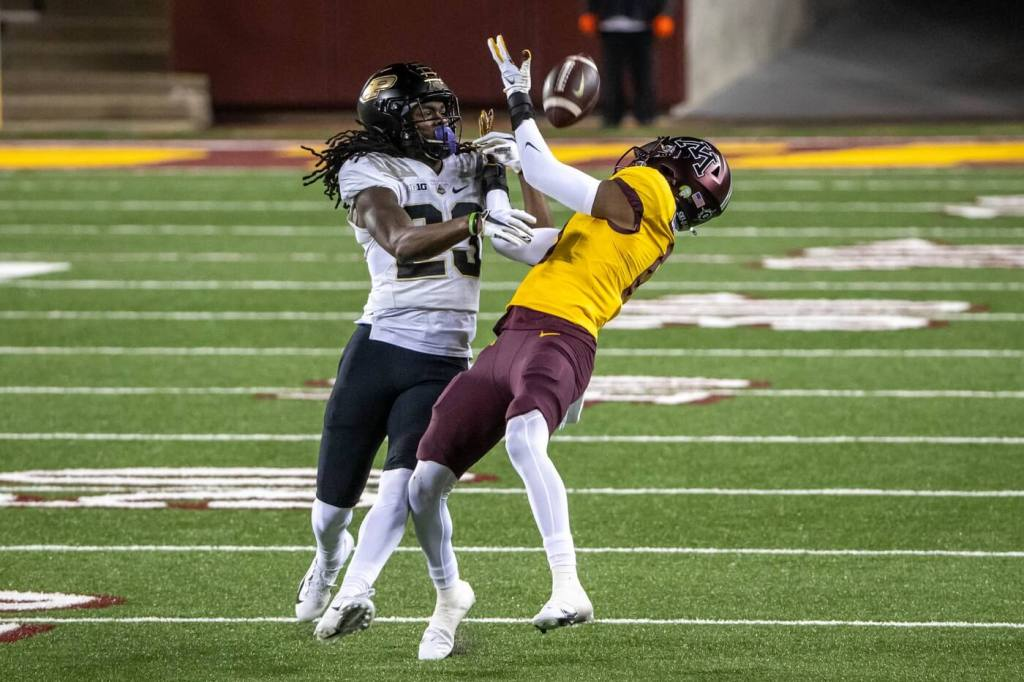 Minnesota Golden Gophers wide receiver Rashod Bateman (0) catches a pass over Purdue Boilermakers safety Cory Trice (23) in the second half at TCF Bank Stadium.