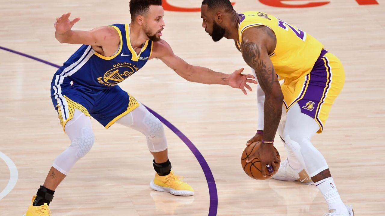 Jan 18, 2021; Los Angeles, California, USA; Golden State Warriors guard Stephen Curry (30) defends Los Angeles Lakers forward LeBron James (23) during the second quarter at Staples Center.