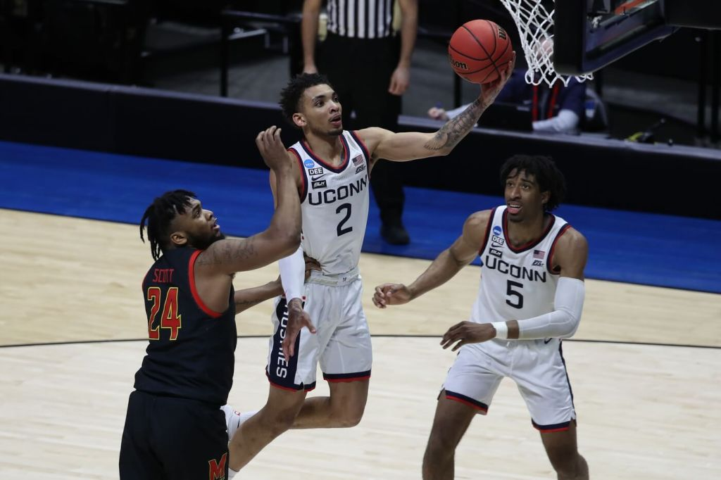 Mar 20, 2021; West Lafayette, Indiana, USA; Connecticut Huskies guard James Bouknight (2) shoots the ball over Maryland Terrapins forward Donta Scott (24) as Connecticut forward Isaiah Whaley (5) looks on during the second half in the first round of the 2021 NCAA Tournament at Mackey Arena. Mandatory Credit: Joshua Bickel-USA TODAY Sports