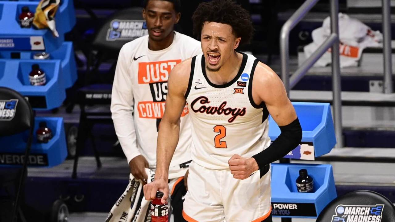 Mar 21, 2021; Indianapolis, Indiana, USA; Oklahoma State Cowboys guard Cade Cunningham (2) yells from the sidelines during the second half in the second round of the 2021 NCAA Tournament against the Oregon State Beavers at Hinkle Fieldhouse. Mandatory Credit: Marc Lebryk-USA TODAY Sports
