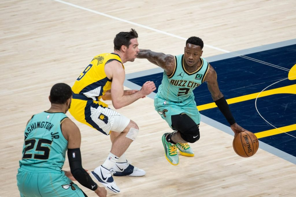 Apr 2, 2021; Indianapolis, Indiana, USA; Charlotte Hornets guard Terry Rozier (3) dribbles the ball while Indiana Pacers guard T.J. McConnell (9) defends in the fourth quarter at Bankers Life Fieldhouse. Mandatory Credit: Trevor Ruszkowski-USA TODAY Sports