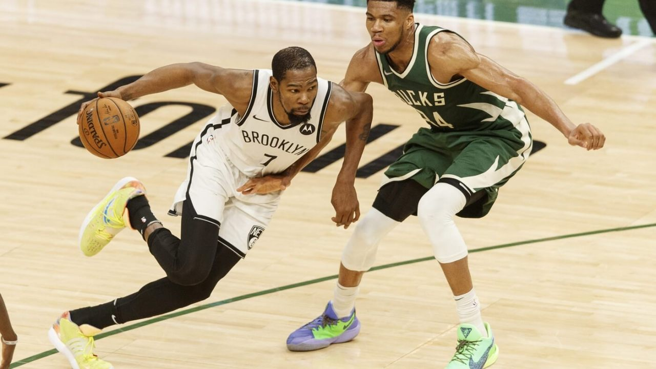 May 2, 2021; Milwaukee, Wisconsin, USA; Brooklyn Nets forward Kevin Durant (7) drives for the basket against Milwaukee Bucks forward Giannis Antetokounmpo (34) during the fourth quarter at Fiserv Forum.