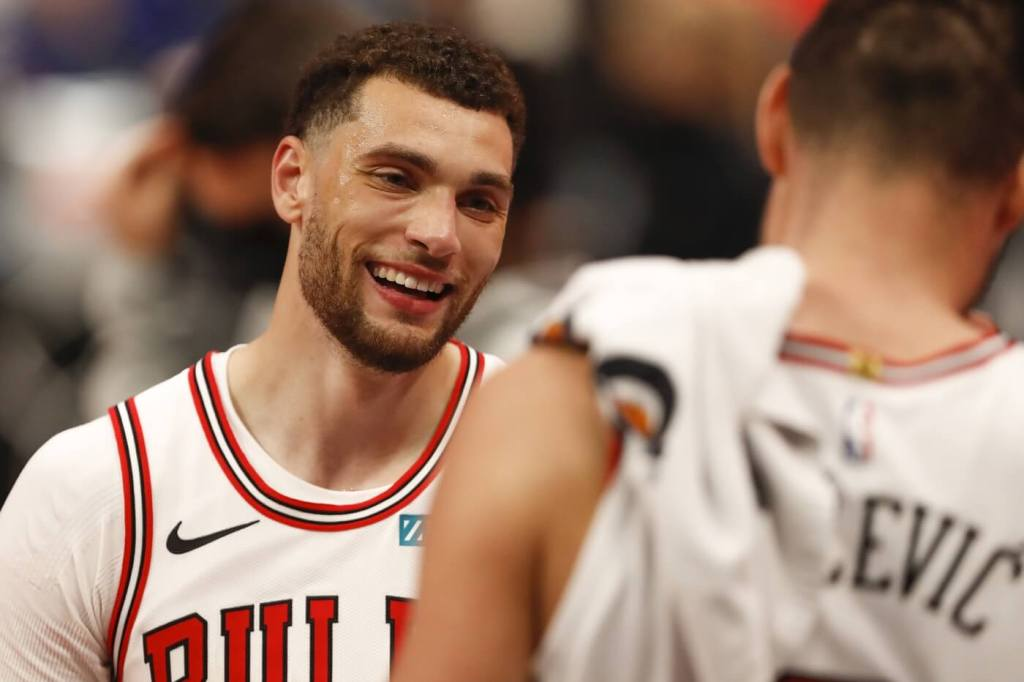 May 9, 2021; Detroit, Michigan, USA; Chicago Bulls guard Zach LaVine (8) smiles at center Nikola Vucevic (9) during the fourth quarter against the Detroit Pistons at Little Caesars Arena. Mandatory Credit: Raj Mehta-USA TODAY Sports