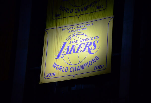 May 12, 2021; Los Angeles, California, USA; The Los Angeles Lakers 2020 champions banner is revealed before the game against the Houston Rockets at Staples Center. Mandatory Credit: Gary A. Vasquez-USA TODAY Sports