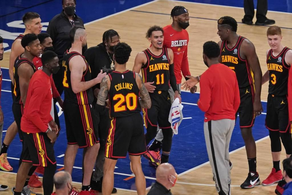 May 23, 2021; New York, New York, USA; Atlanta Hawks guard Trae Young (11) and the rest of team celebrate after game one in the first round of the 2021 NBA Playoffs at Madison Square Garden. The Hawks defeated the Knicks 107-105. Mandatory Credit: Seth Wenig/Pool Photo-USA TODAY Sports