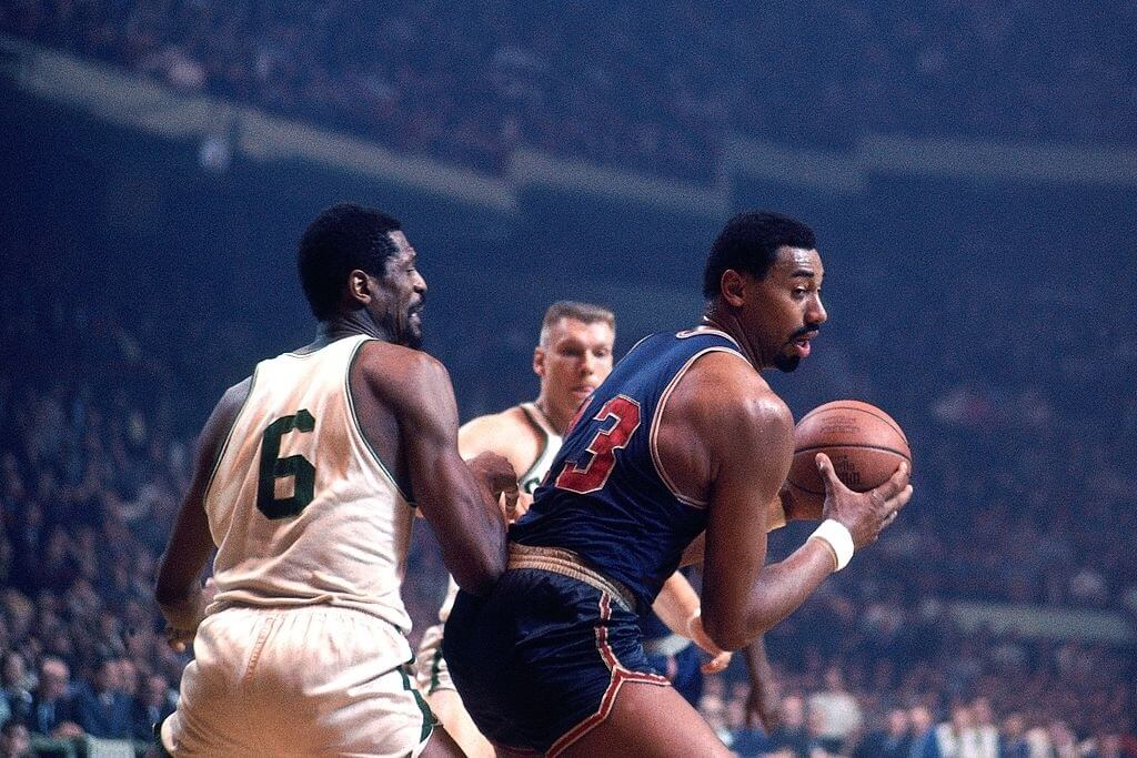 BOSTON - 1967: Wilt Chamberlain #13 of the Philadelphia 76ers posts up against Bill Russell #6 of the Boston Celtics during a game played in 1967 at the Boston Garden in Boston, Massachusetts. NOTE TO USER: User expressly acknowledges and agrees that, by downloading and or using this photograph, User is consenting to the terms and conditions of the Getty Images License Agreement. Mandatory Copyright Notice: Copyright 1967 NBAE (Photo by Dick Raphael/NBAE via Getty Images)
