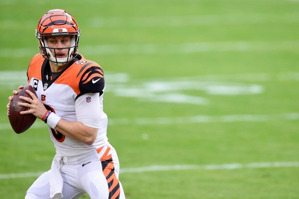 LANDOVER, MARYLAND - NOVEMBER 22: Joe Burrow #9 of the Cincinnati Bengals scrambles with the ball in the first half against the Washington Football Team at FedExField on November 22, 2020 in Landover, Maryland. (Photo by Patrick McDermott/Getty Images)