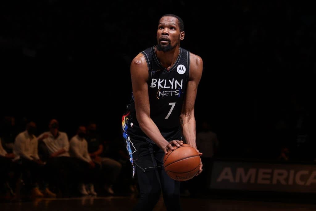 BROOKLYN, NY - MAY 25: Kevin Durant #7 of the Brooklyn Nets shoots a free throw against the Boston Celtics during Round 1, Game 2 of the 2021 NBA Playoffs on May 25, 2021 at Barclays Center in Brooklyn, New York. NOTE TO USER: User expressly acknowledges and agrees that, by downloading and or using this Photograph, user is consenting to the terms and conditions of the Getty Images License Agreement. Mandatory Copyright Notice: Copyright 2021 NBAE (Photo by Nathaniel S. Butler/NBAE via Getty Images)
