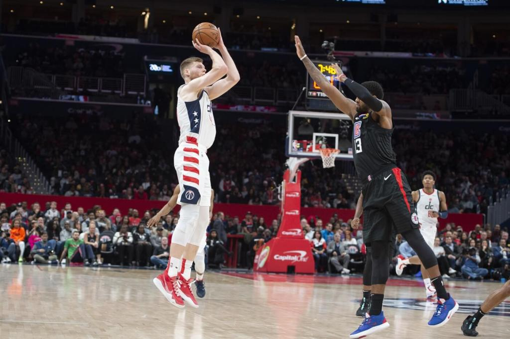 Dec 8, 2019; Washington, DC, USA; Washington Wizards forward Davis Bertans (42) shoots a three point shot as Los Angeles Clippers forward Paul George (13) defends during the second half at Capital One Arena. Mandatory Credit: Tommy Gilligan-USA TODAY Sports