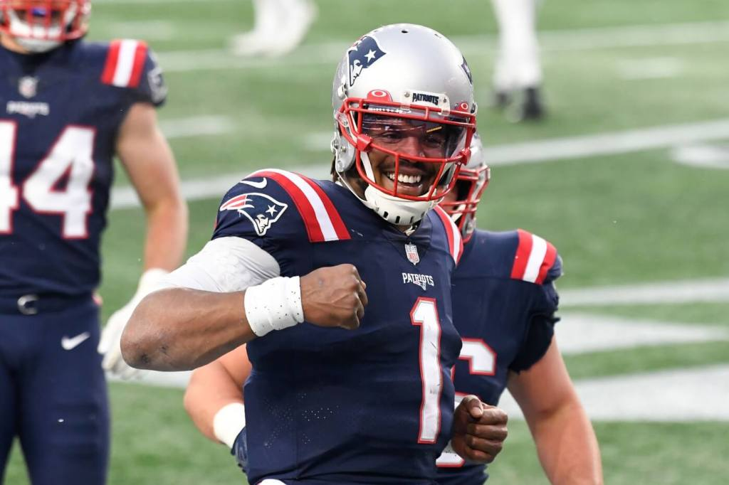 Jan 3, 2021; Foxborough, Massachusetts, USA; New England Patriots quarterback Cam Newton (1) celebrates after scoring a touchdown against the New York Jets during the third quarter at Gillette Stadium. Mandatory Credit: Brian Fluharty-USA TODAY Sports