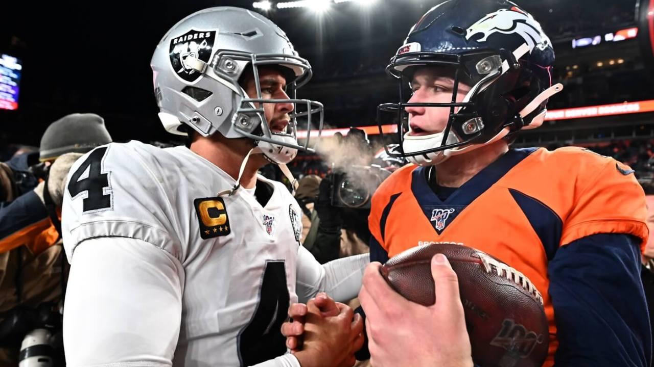 Dec 29, 2019; Denver, Colorado, USA; Oakland Raiders quarterback Derek Carr (4) greets Denver Broncos quarterback Drew Lock (3) following the game at Empower Field at Mile High. Mandatory Credit: Ron Chenoy-USA TODAY Sports