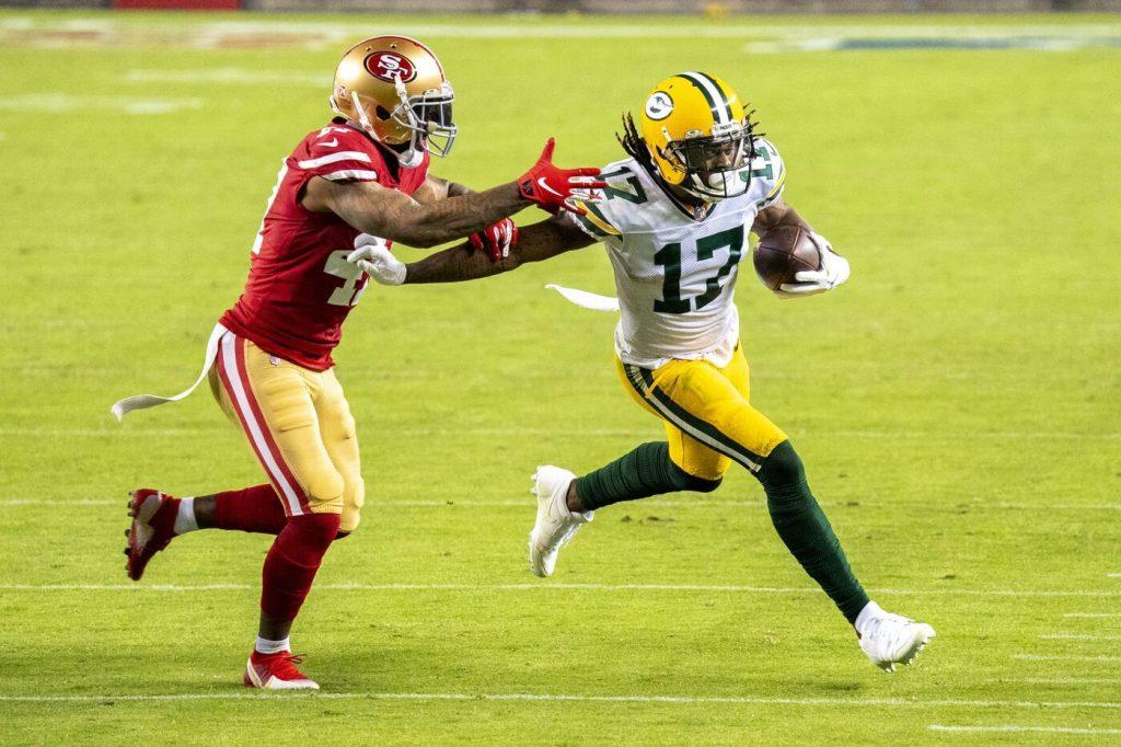 November 5, 2020; Santa Clara, California, USA; Green Bay Packers wide receiver Davante Adams (17) runs the football against San Francisco 49ers cornerback Jamar Taylor (47) during the third quarter at Levi's Stadium. Mandatory Credit: Kyle Terada-USA TODAY Sports