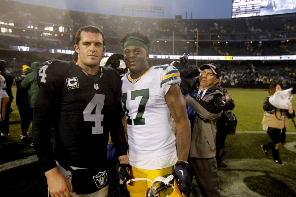 Dec 20, 2015; Oakland, CA, USA; Green Bay Packers wide receiver Davante Adams (17) meets with Oakland Raiders quarterback Derek Carr (4) after the game at O.co Coliseum. The Packers defeated the Raiders 30-20. Mandatory Credit: Cary Edmondson-USA TODAY Sports