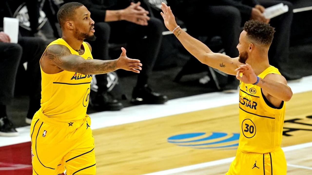 Mar 7, 2021; Atlanta, Georgia, USA; Team Lebron guard Damian Lillard of the Portland Trailblazers (27) and Team LeBron guard Stephen Curry of the Golden State Warriors (30) celebrate during the 2021 NBA All-Star Game at State Farm Arena. Mandatory Credit: Dale Zanine-USA TODAY Sports