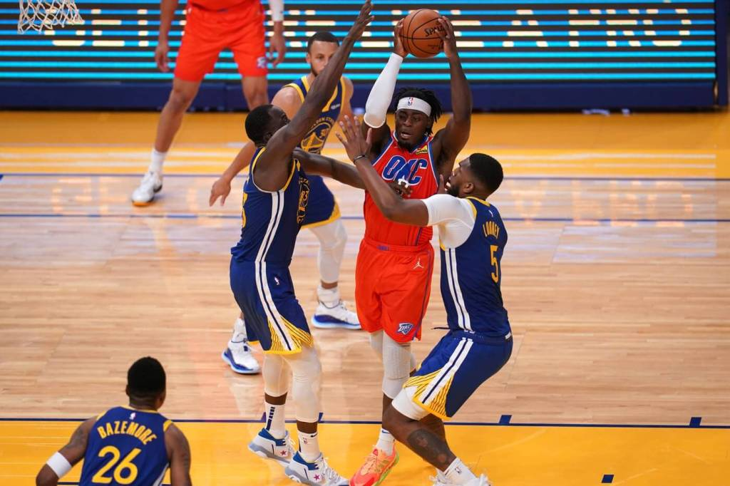 May 8, 2021; San Francisco, California, USA; Oklahoma City Thunder guard Luguentz Dort (5) drives to the hoop against the Golden State Warriors in the third quarter at the Chase Center. Mandatory Credit: Cary Edmondson-USA TODAY Sports